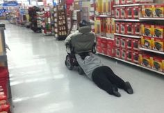 Holding on for Dear Life to a Walmart Scooter - Funny Pictures at Walmart