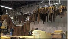 dry cleaners conveyor rack for our next house for sure! they aren't even expensive