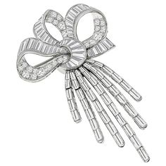 This wonderful platinum diamond bow pin/ pendant is set with high quality sparkling round and baguette cut diamonds that weighs approximately graded F-G color with VS clarity. The pin can also be worn as pendant.It measures by and weighs grams. Diamond Bows, Diamond Brooch, Diamond Flower, Sapphire Pendant, Sapphire Diamond, Diamond Stone, Brilliant Diamond, Vintage Brooches, Baguette