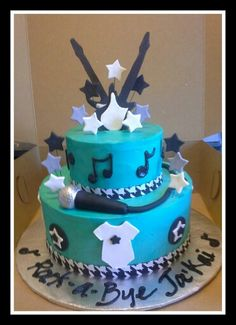 Rock - a - bye baby shower cake. I like the stars and music notes. But the microphone is too much black molded chocolate and fondant.