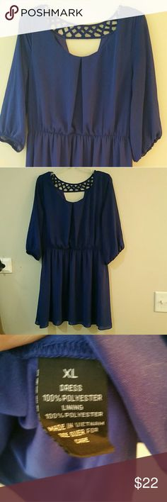 Blue chiffon mini dress with elastic waist Beautiful cut out back and crisscross design.  Elbow length sleeves with elastic for a romantic puff.  Dress is lined andcsleeves are sheer.  Measures 20 inches across the bust and 35 from shoulder to hem. Really adorable.  Has belt loops.  Excellent used condition. By & By Dresses Mini