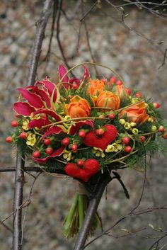 We love this gorgeous, autumn-esque bouquet. It includes some of the most beautiful flowers available only in the autumn season: Gloriosa and Pepper Berry. These unique flowers, shown in deep oranges and reds can fit into a variety of autumn color schemes. #Rockford #SomethingBlueRockford