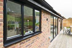 Matching black aluminium windows and doors Aluminium Glass Door, Aluminium Windows And Doors, Pvc Windows, Black Windows, House Windows, Glass Doors, Red Brick Exteriors, Black Window Frames, Window Replacement