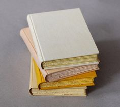 Natalie Stopka's handmade books are made with uncommon fibers, repurposed and hand dyed fabrics, and vintage textiles.