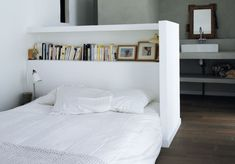 Headboard/shelf/half-wall. Cute for the spare bedroom in a future home, but wouldn't work quite yet.