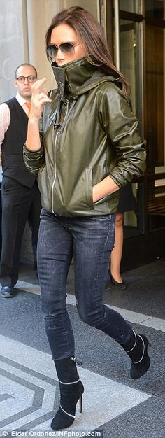 Changing up: Victoria changes into a more casual look later in the day as she leaves her hotel