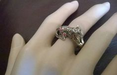Check out this item in my Etsy shop https://www.etsy.com/uk/listing/483189691/beautiful-leopard-ring-coral-silver