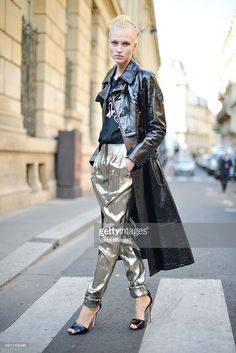 A model poses wearing a Yohji Yamamoto coat and Lanvin pants after the Vivienne Westwood show at the Cordeliers Convent during Paris Fashion Week SS16 on October 3, 2015 in Paris, France.