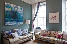 Living room with walls painted in Oval Room Blue by Farrow & ball