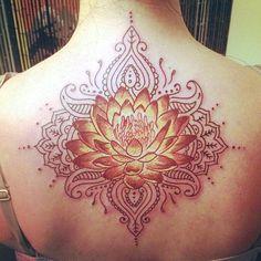 Elegant Lotus tattoo.For more exciting tattoos visit www.tattooenigma.com