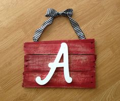 Used an old wood pallet for the board and a wet sponge and spray paint for the color and a pre-made letter. ROLL TIDE!! #alabama