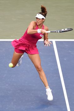 Garbine Muguruza Photos Photos - Garbine Muguruza of Spain in action during her women's singles match against Anastasia Pavlyuchenkova of Russia during day one of the Toray Pan Pacific Open at Ariake Colosseum on September 15, 2014 in Tokyo, Japan. - Toray Pan-Pacific Open: Day 1
