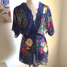 Floral peplum Beautiful blouse! It's a dark blue color. It it has pink, yellow, and blue flowers on it. Lace accents. It's sheer. 100% polyester. Size 2x. The brand is faith 21, which is forever 21's previous plus size brand. Forever 21 Tops Blouses