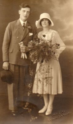 This is a 1920s photo from my extended family. I originally thought this was a wedding couple but having done some research on vintage wedding outfits, I now think that this may have been a bridesmaid with partner or male usher. It's still a beautiful photograph.