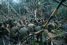 22 Nov 1967, Dak To, South Vietnam --- Men of the 173rd Airborne Brigade bow their heads as they sit on the ground during religious field service, November 22nd, as fighting continues atop Hill 875. --- Image by © Bettmann/CORBIS
