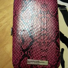 New Listing BCBGMAXAZRIA Snake Pattern Wallet Size Small/ Fits your cell phone and cards/ I can measure to see if it will fit your phone/ Trade $30/ No, low ball offers!!! BCBGMaxAzria Bags Wallets