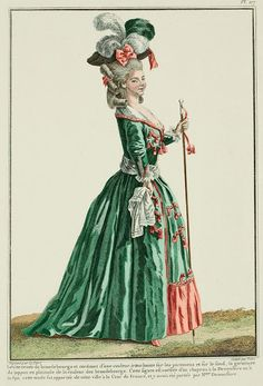 """""""LÉVITE A LA PRUSSIENNE. 1779 The Gown and the petticoat trimmed with brandenburgs. Belt in drapery over the Gown, busquée in front,* to free the waist and give it grace. Sleeves and parements à la cavaliere, opening underneath, following the ancient method abandoned by the Military, because it was inconvenient and because the Minister recognized that it was not economical."""""""