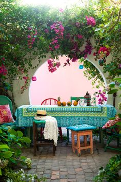 outdoor living. Beautiful arch with flowers and patio.