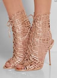 9616a8836460 Heel measures approximately 4 inches Rose gold leather Lace-up front Small  to size. See Size   Fit tab.
