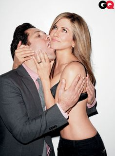 Paul Rudd and Jen... just look what she has to put up with.  I bet it's terrible!