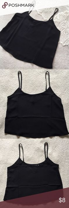 "Black Cropped Tank Top NWOT Cute and classic. This black crop top is a go-to piece. Size Small. Length (shoulder to hem) 20"" Width (armpit to armpit laid flat) 17"" 100% Polyester Ambiance Apparel Tops Crop Tops"