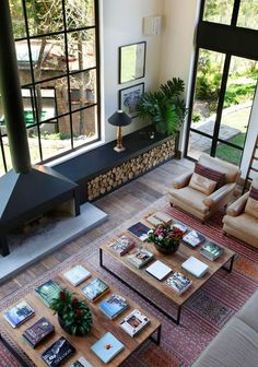 love the pair of huge coffee tables to match the scale of the space