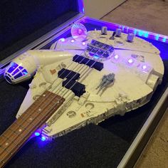 At its most basic, it is everything a guitar should be only it is built within a plastic Millennium Falcon shell. Don't let that fool you though, because this guitar produces a wonderful tone and with a half decent amp, you could amaze everyone by conquering all manner of riffs in less than 12 parsecs!* The original Millennium Falcon bodies are always in good condition, some even perfect - it varies considering they're from anywhere between 1979 and 2004. Some also never had any lights…