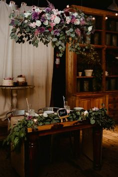 Hanging floral installation over the sweetheart table | Image by The Hursts & Co.