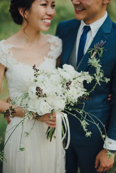 Organic white wedding bouquet // Ivan and Vanessa's Rustic Moss and Terrarium Wedding at The Straits Room