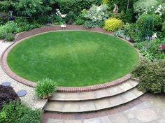 Raised circular lawn as a central garden feature.