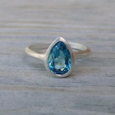 pear shaped London Blue Topaz stone is 9mm x 6mm and it is in a bezel setting, with the back open so light can shine through. This can be custom made in your size, as it is a handmade ring.