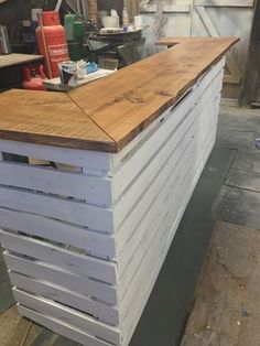 Rustic outdoor pallet bar, with a solid 25mm elm top. All of it can be disassembled for ease of use. Finished with a spray primer and white top coat. The top is finished with a PU lacquer for outdoor use. Has a small elm shelf behind for drinks and utensils. Dimensions 2.6mL x 40cmD x 1mH Can be delivered to address and assembled if needed.