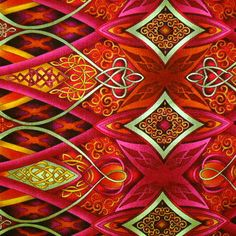 This is the fabric except I used the one with red, geen and purple. Fabric by Paula Nadelstern - Palindromes! I used the wack and stack to make the kaleidoscope blocks in the corners of each set of borders