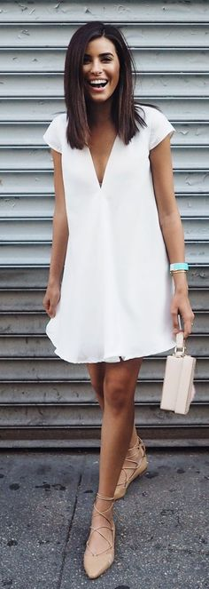 Street style | White mini dress, blush flats, clutch