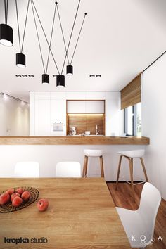 Kitchen and dining room in a minimalist style. Visualization of an interior project by Kropka Studio. Tags: white cabinets, wooden countertop