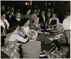 Photograph of people at the roulette table, Sands Hotel and Casino, Las Vegas, circa late 1950s-early 1960s by UNLV Libraries Digital Collections, via Flickr