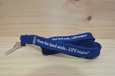 High-quality lanyard and key ring featuring Cape Cod Life's iconic lighthouse and brand philosophy. Printed in white on a rich, royal blue nylon.