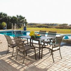 Expecting a larger gathering? The Pelican Reef Island Breeze 7 Piece Dining Group is perfect for a late lunch or dinner while watching the sun set. #Summer #OutdoorEntertaining #DiningSet