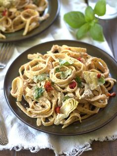 Fettuccine noodles are tossed with artichoke hearts, fresh basil and silky sun-dried tomato hemp seed Alfredo in this vegan twist on an Italian classic. Perfect for Meatless Monday.
