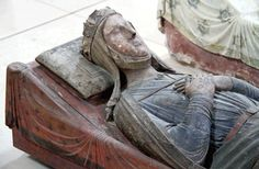 1246, Fontevrault Abbey, France. Wood Effigy of Isabelle of Angoulême (1188-1246), Queen of England, second wife of John I. Queen from 1200 - 1216. King John divorced his first wife, Isabel of Gloucester, to marry Isabella. She had many children with him, including the future Henry III. After his death she remarried Hugh X of Lusignan, who was supposed to marry her daughter Joan, but jilted the girl to marry her mother. She had several more children with him.
