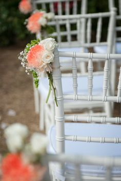 Tying roses along the sides of your wedding chairs is a cute way to dress up your aisle!