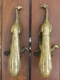 ♅ Detailed Doors to Drool Over ♅ art photographs of door knockers, hardware & portals - Peacock door handles.