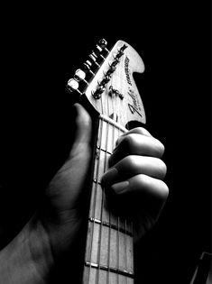 Fender Stratocaster - Maple neck, 70's oversized headstock.  Maybe a paisley Strat.