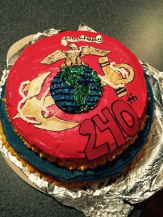 Marine cake I made for my fiancée for the marines 240th birthday. 100% edible. I hand painted the decals with coloring on sugar paper, and the globe Is cake I cut out of the bottom and painted with icing. : )
