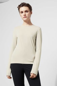 The Hue Long Sleeve is a take-it-everywhere basic made of a stretchy material. It has a jewel neckline and fitted sleeves. -The model wears size small, tha