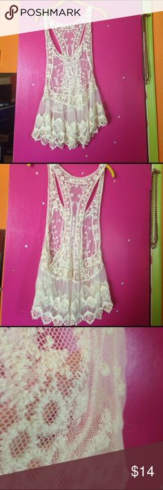 White top Good condition white mesh / see through top!can't remember where I purchased it but I've worn it one time to a party.There's a small pink lipstick stain on the front (3rd pic) and I do mean VERY small! Hard for me to take a pic of it. And 4th pic shows a stain on the back also hard to see if you're looking at the top as a whole.There's no tag so I'm unsure of the size. My guess is a XL but I'm a L and it fits.Please look at my other items I love to bundle just as much as you love…