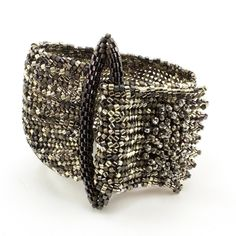 Try your hand at this absolutely beautiful statement bracelet! It is made using flat herringbone and peyote stitches. Increases and decreases in the herringbone