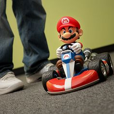 Experience all the excitement of Mario Kart racing just about anywhere. This kart includes a scale Mario in his kart with a controller. Super Nintendo, Super Mario Bros, Yoshi, Bear Sleeping Bags, Mario Kart Ds, Super Cool Stuff, Fun Stuff, Mickey Mouse, Geek Toys