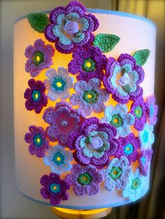 Lamp decorated with crochet flowers