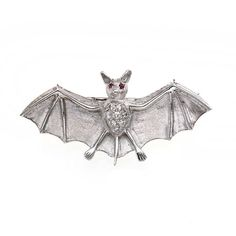 A gold, diamond and ruby brooch in the form of a bat, symbol of the night. (Heming)